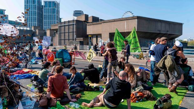 Climate change activists blocking Waterloo Bridge in London on the sixth day of protests by Extinction Rebellion. Photograph: Niklas Halle'n/AFP/Getty Images
