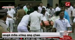 A victim is rushed to a hospital after explosions hit churches and hotels in Colombo, Sri Lanka. Photograph: Derana TV/Reuters.