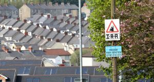 A picture shows an IRA sniper warning sign overlooking the Bogside area of Derry. Photograph: Paul Faith/AFP/Getty Images