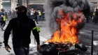 French police fire tear gas in clashes with yellow-vest protestors