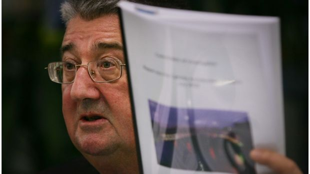 Archbishop Diarmuid Martin holds a copy of the report on sexual abuse. Photograph: Bryan O'Brien/The Irish Times