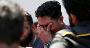 A relative of a victim of the explosion at St Anthony's Shrine, Kochchikade church reacts at the police mortuary in Colombo, Sri Lanka. Photograph: Dinuka Liyanawatte/Reuters