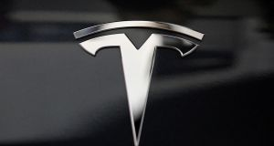 The Tesla logo. The company claims it identified the harasser from the licence plate of the vehicle he drove. Photograph: Lucy Nicholson/Reuters