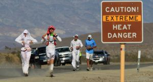 Runners taking part in the   Badwater Ultramarathon  in Death Valley in 54 degree summer heat. Photograph: Getty Images