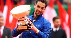 Fabio Fognini holds the winner's trophy after beating   Dusan Lajovic   in the men's singles final during at Monte-Carlo Masters. Photograph: Clive Brunskill/Getty Images