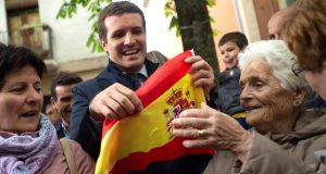 Popular Party candidate Pablo Casado greets a group of supporters during his visit to Pamplona, Spain, during the electoral campaign. Photograph: Inaki Porto/EPA