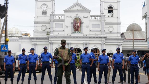 Sri Lankan soldiers secure the area around St Anthony's Shrine after a blast in Colombo. Photograph: Eranga Jayawardena/AP Photo