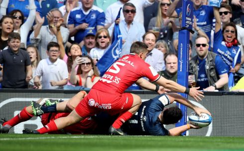 Leinster's James Lowe scores a try despite Rynhardt Elstadt and Thomas Ramos of Toulouse. Photo: Dan Sheridan/Inpho