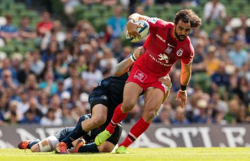 Toulouse's Yoann Huget is tackled by Sean O'Brien. Photo: Billy Stickland/Inpho