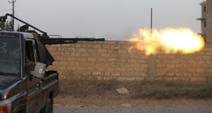 Members of Libyan  government forces fire during fighting  in Ain Zara, Tripoli. Photograph: Hani Amara/Reuters