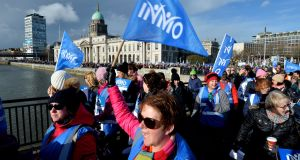 INMO's Phil Ní Sheaghdha marching with nurses and midwives in Dublin: About 17,000 healthcare assistants, other hospital support staff and chefs will begin a ballot on Monday for strike action. Photograph: Alan Betson