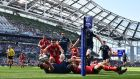 James Low dives to score Leinster's opening try against Toulouse. Photograph: Dan Mullan/Getty