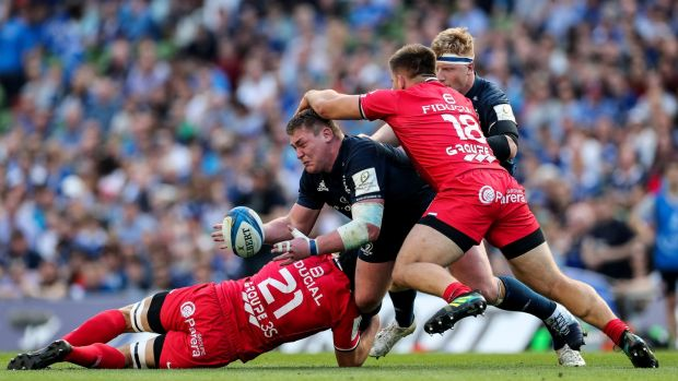Leinster's Tadhg Furlong is tackled by Francois Cros and Maks Van Dyk during his side's win over Toulouse. Photograph: Billy Stickland/Inpho
