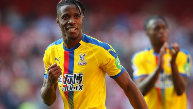 Wilfried Zaha celebrates Crystal Palace's victory over Arsenal at the Emirates. Photograph: Warren Little/Getty