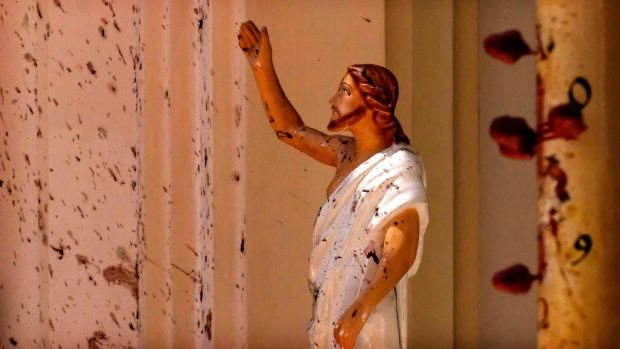 Blood stains on the wall and Jesus Christ statue at St Sebastian Church in Negombo, north of Colombo in Sri Lanka. More than 200 people were killed in eight blasts. Photograph: AP