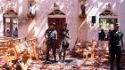 SRI LANKA: Soldiers look on inside the St Sebastian's Church at Katuwapitiya in Negombo on April 21st following a bomb blast during the Easter service that killed tens of people. A series of eight devastating bomb blasts ripped through high-end hotels and churches holding Easter services in Sri Lanka on Sunday, killing over 200 people. Photograph: STR/AFP/Getty Images