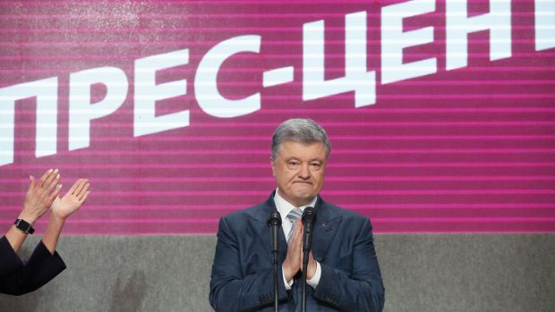 Ukrainian president and presidential candidate Petro Poroshenko following exit poll results. Photograph: Sergey Dolzhenko/EPA