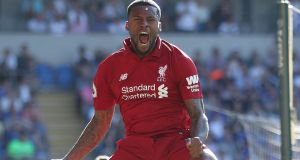Liverpool's Georginio Wijnaldum celebrates scoring his side's first goal in their 2-0 win over Cardiff at Cardiff City Stadium. Photograph:  David Davies/PA Wire