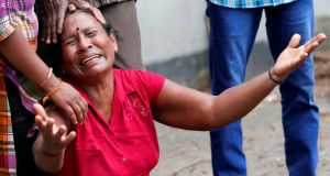 A relative of a victim of the explosion at St Anthony's Shrine reacts at the police mortuary in Colombo, Sri Lanka. Photograph: Dinuka Liyanawatte/Reuters