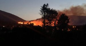 Smoke rises from the area on fire in the Mountains of Mourne in Co Down. Photograph: Chris Law/Twitter