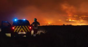 Fire crews from two stations working in to the early hours of  Monday morning to bring a large mountain fire under control in east Clare.  Photograph: Press 22