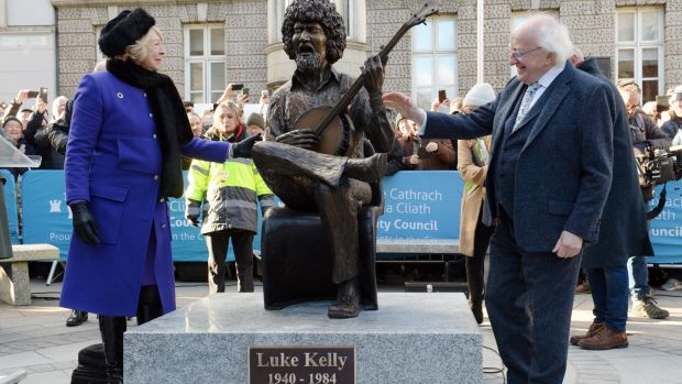 The President and wife Sabina after unveil John Coll's after statue on South King Street, Dublin. Photograph: Dara Mac Donaill/The Irish Times