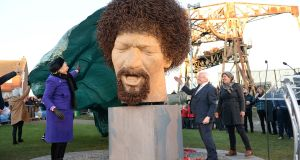 President Michael D Higgins and his wife Sabina, unveiling artist Vera Klute's Luke Kelly statue, on Guild Street, Dublin,   earlier this year. Photogralph: Dara Mac Dónaill/The Irish Times