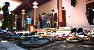 Shoes of victims are kept as evidence as security personnel inspect the interior of St Sebastian's Church, a day after the church was hit in series of bomb blasts targeting churches and luxury hotels in Sri Lanka. Photograph: Jewel Samad/AFP/Getty  Images