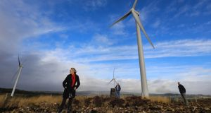 Fred O'Sullivan (right), chairman of the Sliabh Luachra Wind Awareness Group, with Peter and Caroline Cooke at the wind farm at Barna, near Scartaglen in Co Kerry. Photograph: Valerie O'Sullivan