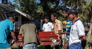 Relatives in Negombo, Sri Lanka, unload the coffin  of Sneha Savindi (12) who was killed in a suicide bombing at St Sebastian's Church on Sunday. Phototgraph: Adam Dean/The New York Times