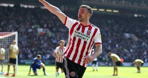 Sheffield United's Enda Stevens celebrates scoring his side's third goal against Hull. Photograph: Nigel French/PA
