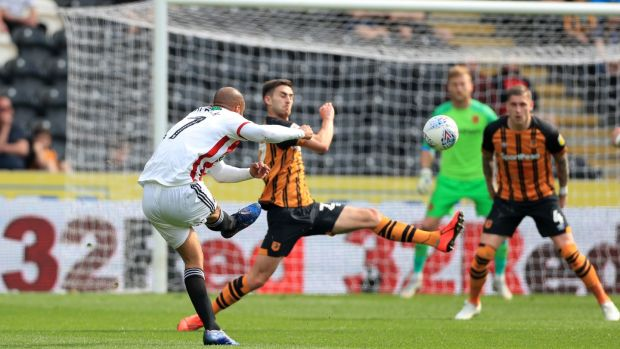 Sheffield United's David McGoldrick scores his side's second goal in their win over Hull. Photograph: Mike Egerton/PA