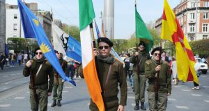 Members of Republican Sinn Féin stand on Dublin's O'Connell Street  during their Easter Rising commemoration on Monday. Photograph: Aidan Crawley/The Irish Times