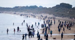 People enjoy the warm weather on Portmarnock Beach on Easter Sunday. Photograph: Tom Honan/The Irish Times