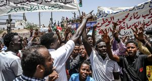 Demonstrators protest outside   Sudan's army headquarters in the capital Khartoum. Photograph: Getty Images