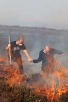 A father and son battle the gorse fires in Donegal. Photograph: Brid Sweeney