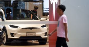 A Tesla showroom in Beijing. The   electric automaker has launched an investigation after a video circulating in China showed one of its cars suddenly burst into flames in a garage in Shanghai. Photograph: Getty Images