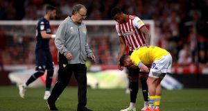 Leeds United manager Marcelo Bielsa and Pablo Hernandez after the Sky Bet Championship match at Griffin Park in Brentford. Photograph: PA