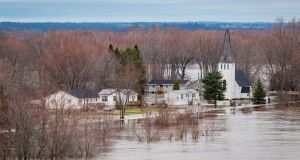 Flooding  along the Saint John River at  Maugerville, New Brunswick, Canada. Photograph:  Canadian armed forces