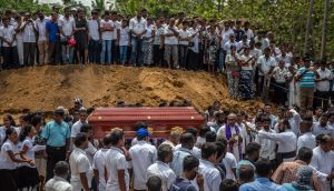 A coffin is carried to a grave during a mass funeral at St Sebastian Church on April 23rd, 2019 in Negombo, Sri Lanka. Photograph Carl Court/Getty Images