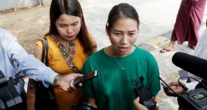 Chit Su Win (left), wife of jailed Reuters journalist Kyaw Soe Oo, listens to Pan Ei Mon, wife of journalist Wa Lone, speaking to the media after the court hearing in Naypyidaw, Myanmar on Monday. Photograph: Thet Aung/AFP/Getty Images