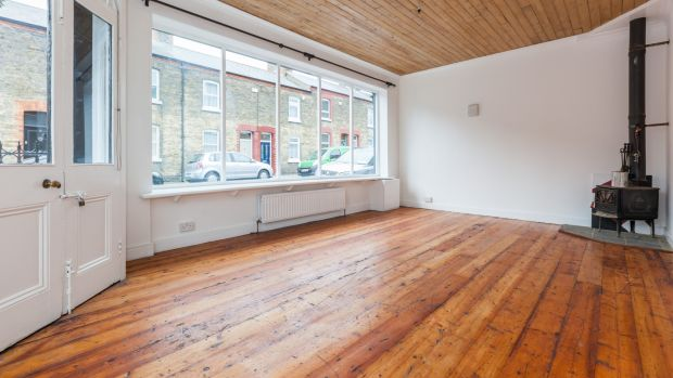 The 'shop' part of the property features two large picture windows, a wood-burning stove in the corner and lovely pitch pine floorboards underfoot