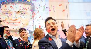 Volodymyr Zelenskiy reacts following the announcement of the results of the first exit poll in the presidential election runoff,  at his campaign headquarters in Kiev, Ukraine. Photograph:  Valentyn Ogirenko/Reuters
