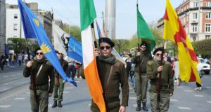 Members of Republican Sinn Féin stand on Dublin's O'Connell Street during their Easter Rising commemoration on Easter Monday. Photograph: Aidan Crawley/The Irish Times