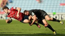 Munster's Darren Sweetnam is tackled by Saracens' Alex Goode during the Champions Cup semi-final at the Ricoh Arena in Coventry. Photograph: David Rogers/Getty Images