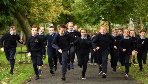 Pupils of Scoil Muire Gan Smal in  Inchicore, Dublin, taking part in the Daily Mile. Photograph: Seb Daly/Sportsfile