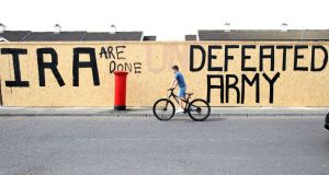 "Graffiti that has been amended to read ""IRA are done. Defeated Army"" instead of ""IRA undefeated Army"" in the Creggan area of Derry  close by the scene where  journalist yra McKee was fatally shot amid rioting on April 18. Photograph:Paul Faith/AFP/Getty Images"