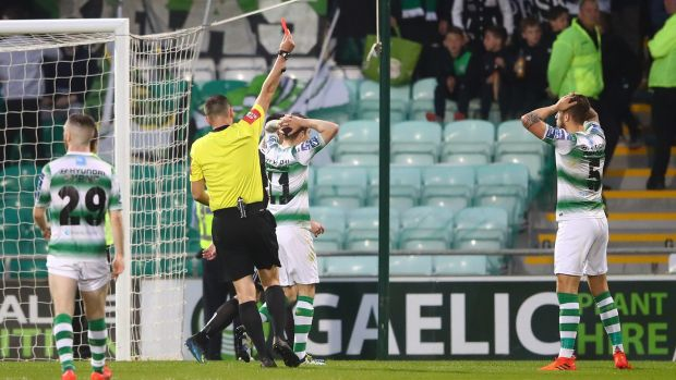 Referee Paul McLaughlin sends off Lee Grace during Shamrock Rovers' defeat to Bohemians. Photograph: James Crombie/Inpho