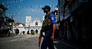 A security guard stands near St Anthony's Shrine in Colombo on Wednesday. Photograph: Getty Images
