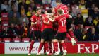 Southampton celebrate Shane Long's early opener against Watford. Photograph: Marc Atkins/Getty